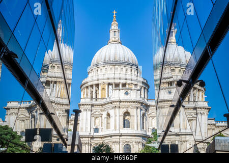 St Pauls Cathedral and its reflection from glass walls of One New Change building in London - Stock Photo