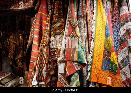 Oriental ornate rugs and carpets on display - Stock Photo