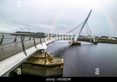 Peace bridge Northern Ireland With rainbow - Stock Photo