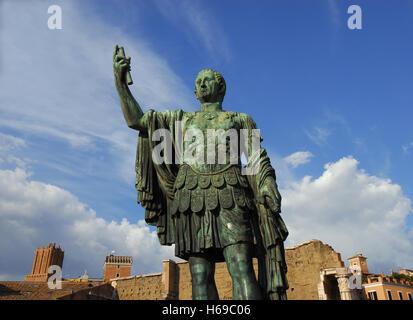 Bronze statue of Nerva, ancient roman emperor, in front of Imperial Forum of Rome - Stock Photo
