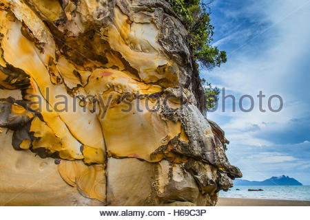 Erosion evidence is clear on waterside rock formations. - Stock Photo