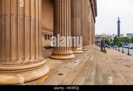 Columns of St George's Hall and Benjamin Disraeli Statue on steps,  Wellington's Column in B/G Liverpool, Merseyside, - Stock Photo