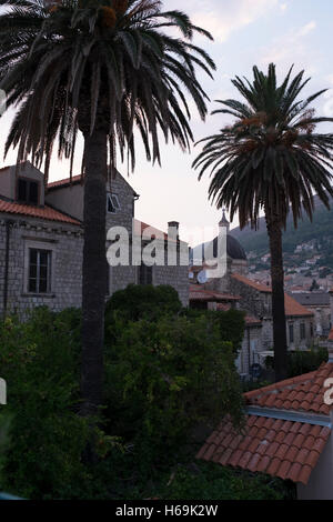 Sunset descends on the red tile roofs of the UNESCO World Heritage Site of the city of Dubrovnik, Croatia, along - Stock Photo