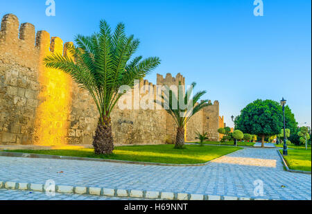 The medieval walls of Sousse Medina look even more beautiful, because of the green garden surrounding them, Tunisia. - Stock Photo