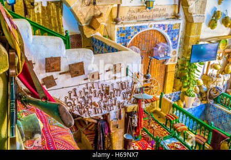 The different old stuff, furniture and rugs are the best decorations for traditional arabic restaurant - Stock Photo
