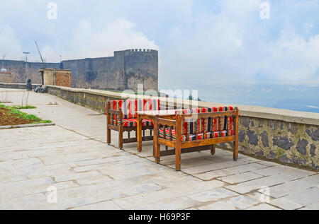 The outdoor cafe, located outside the old citadel walls of Diyarbakir with the foggy view on the Mesopotamian plain, - Stock Photo