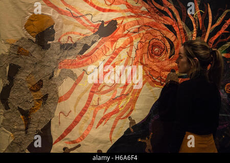 London, UK. 26 October 2016. A museum employee looks at the artwork Creation of the Sun, 2015, by artists from the - Stock Photo