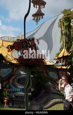 hall of mirrors reflection of male tourist in tivoli gardens amusement park copenhagen denmark - Stock Photo