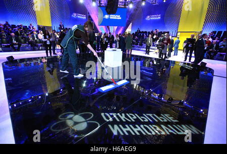 Moscow, Russia. 26th Oct, 2016. Mopping the floor at the 2016 Open Innovations Forum at the Skolkovo Technopark. - Stock Photo