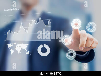 Head-up display interface showing business intelligence dashboard and charts with businessman fingers touching virtual - Stock Photo