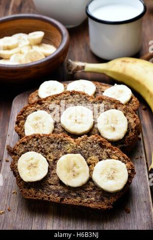 Slices of homemade banana bread, healthy baking - Stock Photo