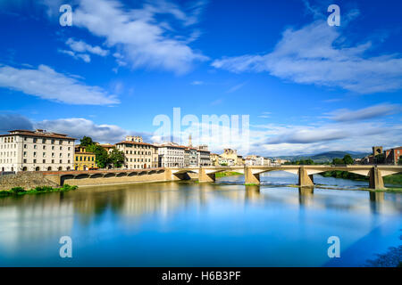 Florence or Firenze, Ponte alle Grazie bridge landmark on Arno river, sunset landscape with reflection. Tuscany, - Stock Photo