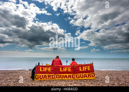 Lifeguards on Brighton beach - Stock Photo