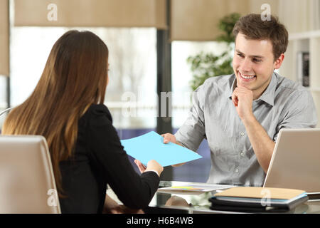 Businesspeople meeting and working and sharing documents in a desk at office - Stock Photo