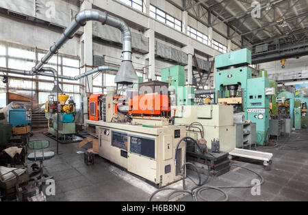 Machine-building plant. Shop with machines for production of plastic parts. Injection molding thermoplastic machine - Stock Photo