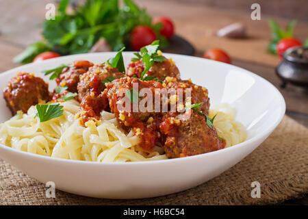 Fettuccine Pasta with meatballs in tomato sauce. - Stock Photo