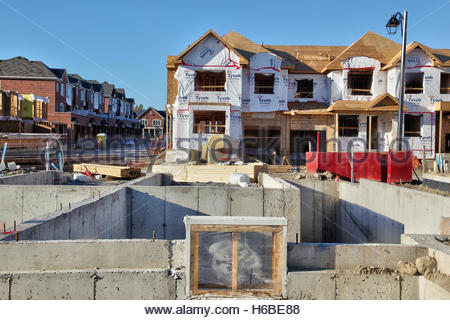 New subdivision with houses under construction in for Building a house in ontario