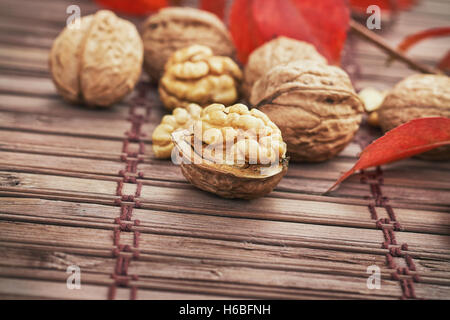 Walnuts on wooden background with copy space - Stock Photo