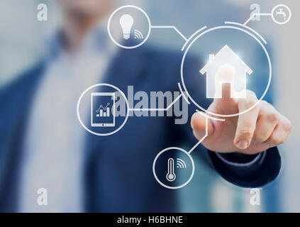 Smart home interface with button and icons providing control to temperature and lamps from mobile app - Stock Photo
