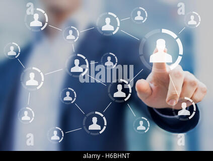 Social network structure showing connections between people's profiles, virtual interface with person in background - Stock Photo