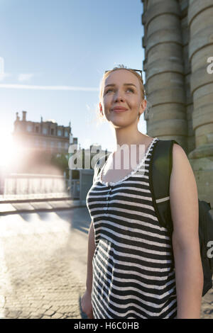 Portrait of a Stylish Pretty Young Woman traveling throug city - Stock Photo