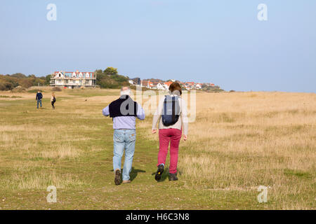 People walking the Suffolk Coast Path between Aldeburgh and Thorpeness, Suffolk England UK - Stock Photo