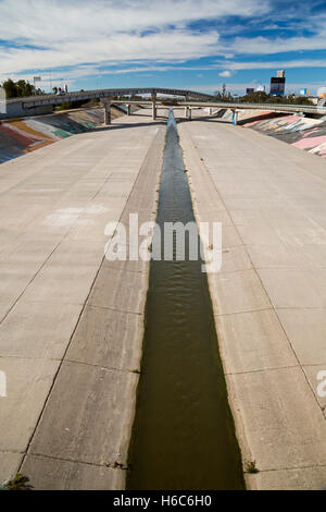 Tijuana, Mexico - The Tijuana River flows in a concrete channel. - Stock Photo