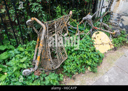 Old supermarket trolley dredged out of the Regent's Canal in London. - Stock Photo