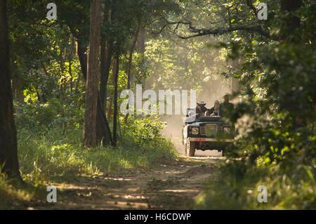 NEPAL, Royal Bardia National Park, ecotourists on a jeep safari - Stock Photo