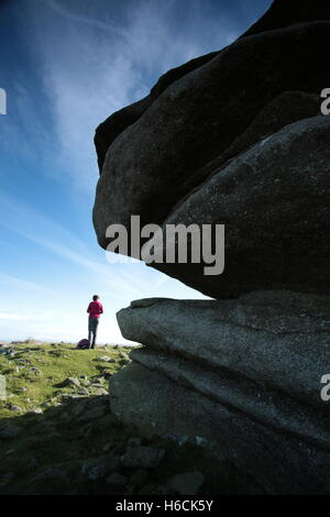 A woman standing by Showery tor,Bodmin moor. - Stock Photo