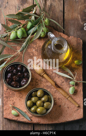 Olives with bread and oil - Stock Photo
