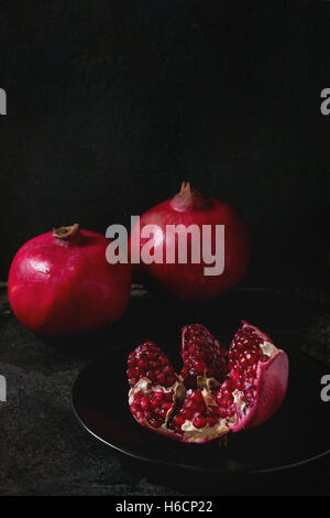 Slice and whole pomegranates - Stock Photo