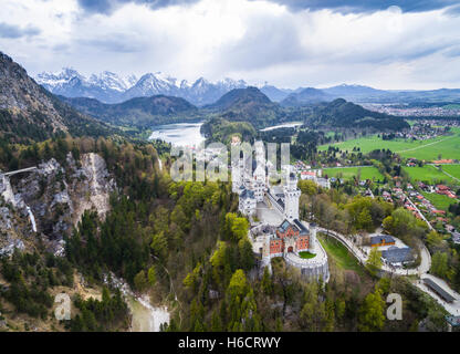Aerial view of Neuschwanstein Castle with Lake Alpsee and Bavarian Alps, Schwangau, Ostallgäu, Allgäu, Swabia, Upper - Stock Photo