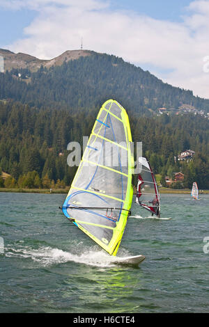 Surfer on Heidsee lake, Lenzerheide, Grisons, Switzerland, Europe - Stock Photo