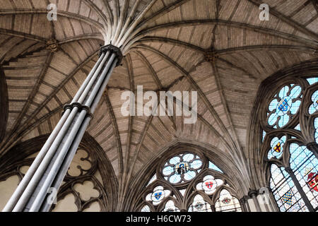 Chapter House ceiling, Westminster Abbey, showing stained glass windows and architectural detail in roof and pillar. - Stock Photo