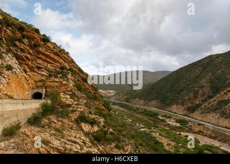 View from the Kouga Dam with a Tunnel and side road. - Stock Photo