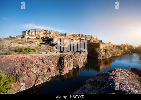 Mehrangarh fortress in the dessert and pound Jodhpur blue city, Rajasthan, India - Stock Photo