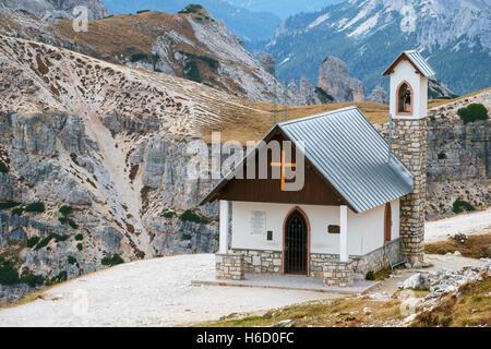 Mountain chapel near Tre Cime di Lavaredo in Dolomites Alps, Italy - Stock Photo