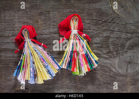 Slavic talisman doll. Russian traditional rag doll handmade. Top view, copy space. Sewing crafts. - Stock Photo