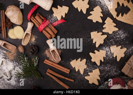 Frame of baking ingredients and tolls for gingerbread dough preparation. Christmas cookies and spices over rustic - Stock Photo