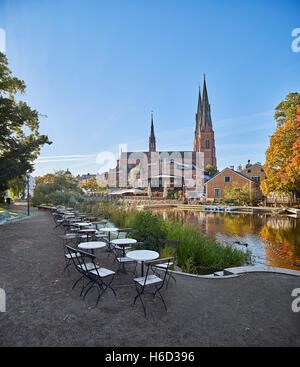 The Cathedral and the Fyris river (Fyrisan) in the autumn, Uppsala, Sweden, Scandinavia - Stock Photo