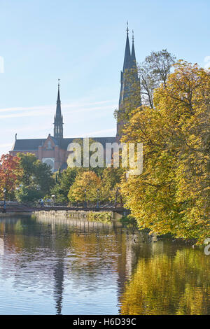 The Cathedral and the Fyris river in the autumn with the Jernbron (Iron Bridge) in the foreground, Uppsala, Sweden, - Stock Photo