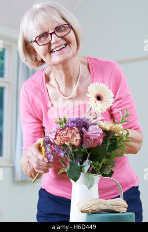 Senior Woman In Flower Arranging Class - Stock Photo