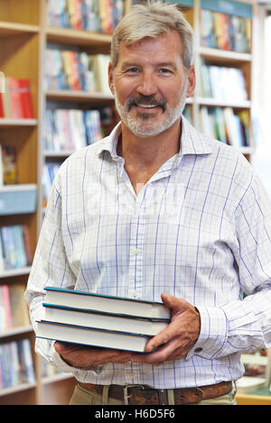 Portrait Of Male Bookshop Owner - Stock Photo