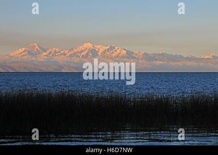 Cordillera real mountain range at sunset behind Titicaca lake - Stock Photo