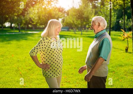 Senior man and woman outdoors. - Stock Photo