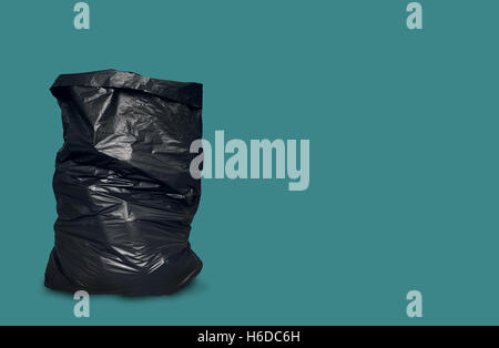 Garbage Bag Isolated on Green Blue Background with Clipping Path - Stock Photo