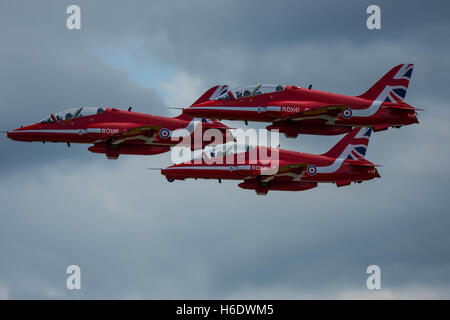 Three Red Arrows taking off from Hawarden - Stock Photo