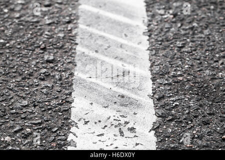 White dividung line with tire tracks, highway road marking. Abstract transportation background - Stock Photo