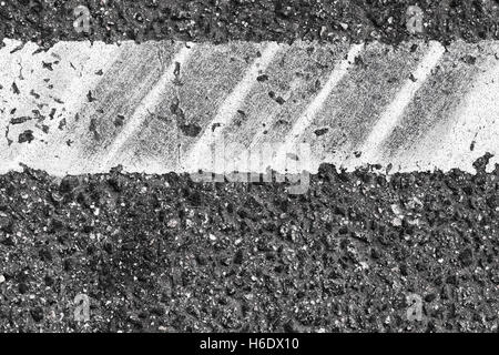 White dividung line fragment with tire tracks over it, highway road marking. Abstract transportation background - Stock Photo